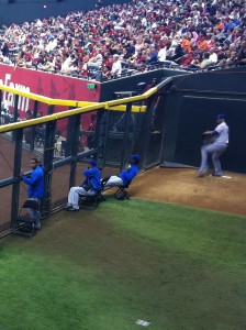 arizona diamondbacks vs new york mets at phoenix's chase field - a mets pitcher warming up